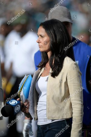 CBS Sports sideline reporter Tracy Wolfson watches from the sideline during the second half of an NFL football game between the Jacksonville Jaguars and the Pittsburgh Steelers, in Jacksonville, Fla