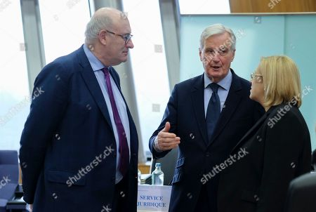 Michel Barnier, the European Chief Negotiator of the Task Force for the Preparation and Conduct of the Negotiations with the United Kingdom under Article 50, and Irish Phil Hogan (L), European Commissioner for agriculture and rural development, and European Commissioners Corina Cretu (R) during the weekly college meeting of the European commission in Brussels, Belgium, 21 November 2018. During the session European Commission members should agree and sign the draft Brexit withdrawal agreement. Later on the day Britain's Prime Minister Theresa May is expected to visit the European Commission.