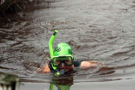 Bog snorkelling participant Nia Roberts from Abergele, north Wales in a Wonder Woman outfit