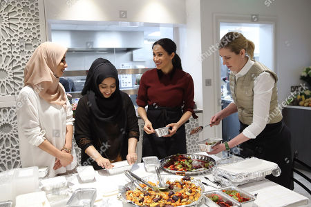 Meghan Duchess of Sussex with chef Clare Smyth (R) as they visit the Hubb Community Kitchen to see how funds raised by the 'Together: Our Community' Cookbook are making a difference at Al Manaar, North Kensington