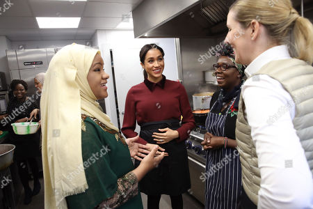 Meghan Duchess of Sussex talks to chef Clare Smyth as she visits the Hubb Community Kitchen to see how funds raised by the 'Together: Our Community' Cookbook are making a difference at Al Manaar, North Kensington