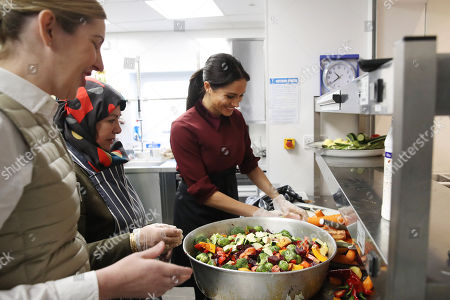 Meghan Duchess of Sussex and chef Clare Smyth visit the Hubb Community Kitchen to see how funds raised by the 'Together: Our Community' Cookbook are making a difference at Al Manaar, North Kensington