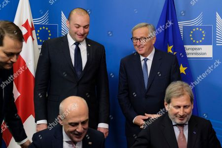 Georgia's prime minister Mamuka Bakhtadze (rear, L) and European Commission President Jean-Claude Juncker (rear, R) attend a signature ceremony of an agreement with David Zalkaliani, the Georgian Foreign Minister, and EU commissioner for Enlargement Negotiations Johannes Hahn (front, R) during a meeting of the Georgian Government with the EU commission in Brussels, Belgium, 21 November 2018. The high-level meeting takes place in the context of flourishing relations between the European Union and Georgia, both on a bilateral basis and in the context of the Eastern Partnership initiative.