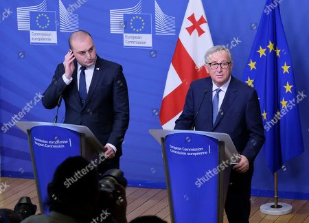 Georgia prime minister Mamuka Bakhtadze (L) and European Commission President Jean-Claude Juncker attend a news conference during a meeting of the Georgian Government with the EU commission in Brussels, Belgium, 21 November 2018. The high-level meeting takes place in the context of flourishing relations between the European Union and Georgia, both on a bilateral basis and in the context of the Eastern Partnership initiative.