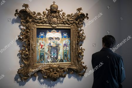 A visitor looks at a  work entitled 'The King of Pop' by artist Mark Ryden depicting Michael Jackson displayed as part of the 'Michael Jackson: On the Wall' exhibition at the Grand Palais in Paris, France, 21 November 2018. The exhibtion gathers works of art by various artists relating to Michael Jackson, exploring his cultural impact on the art scene. The exhibition runs from 23 November 2018 to 14 February 2019.