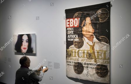 A visitor looks at 'Black Ebony II' by artist Lyle Ashton Harris displayed as part of the 'Michael Jackson: On the Wall' exhibition at the Grand Palais in Paris, France, 21 November 2018. The exhibtion gathers works of art by various artists relating to Michael Jackson, exploring his cultural impact on the art scene. The exhibition runs from 23 November 2018 to 14 February 2019.