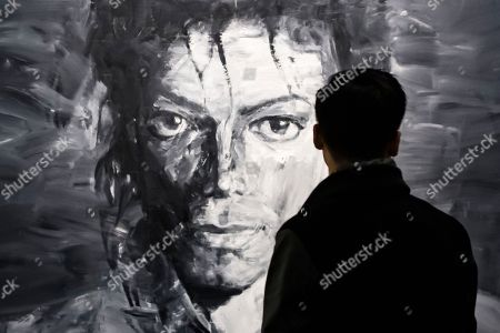 A visitor looks at a work of art by artist Yan Pei-Ming displayed as part of the 'Michael Jackson: On the Wall' exhibition at the Grand Palais in Paris, France, 21 November 2018. The exhibtion gathers works of art by various artists relating to Michael Jackson, exploring his cultural impact on the art scene. The exhibition runs from 23 November 2018 to 14 February 2019.
