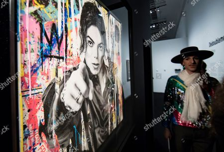 A visitor looks at works by artist Mr Brainwash depicting Michael Jackson displayed as part of the 'Michael Jackson: On the Wall' exhibition at the Grand Palais in Paris, France, 21 November 2018. The exhibtion gathers works of art by various artists relating to Michael Jackson, exploring his cultural impact on the art scene. The exhibition runs from 23 November 2018 to 14 February 2019.