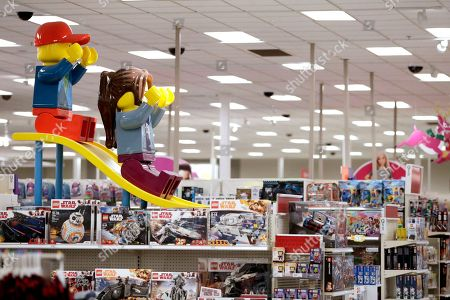 A display shows two large Lego toys on a slide near the toy section at a Target store in Bridgewater, N.J. Companies from Target to online mattress company Casper aren't just counting on a stronger economy to pump up sales. Target's CEO Brian Cornell estimated last month there's up to $100 billion in market share for grabs, double what he foresaw just a year ago. So Target is accelerating its store remodels in areas where bankrupt retailers had stores