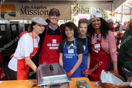 Minnie Driver, Eric Garcetti, Jax Joseph Nilon, Jaid Thomas Nilon, Garcelle Beauvais. Minnie Driver, from left, Los Angeles Mayor Eric Garcetti, Jax Joseph Nilon, Jaid Thomas Nilon and Garcelle Beauvais pose for a photo at the Los Angeles Mission where they served Thanksgiving dinner to the homeless, in Los Angeles