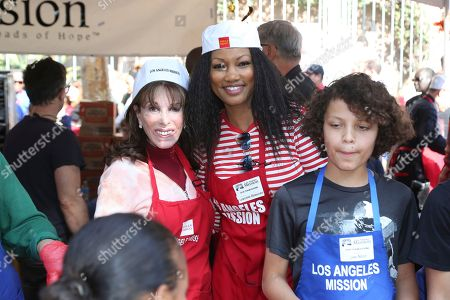 Kate Linder, Garcelle Beauvais, Jax Joseph Nilon. Kate Linder, from left, Garcelle Beauvais and Jax Joseph Nilon volunteer to serve Thanksgiving dinner to a group of homeless people at the Los Angeles Mission, in Los Angeles