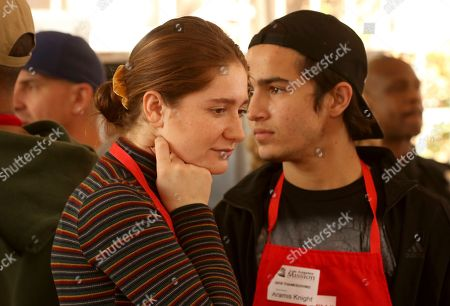 Emma Kenney, Aramis Knight. Emma Kenney, left, and Aramis Knight volunteer to serve Thanksgiving dinner to a group of homeless people at the Los Angeles Mission, in Los Angeles