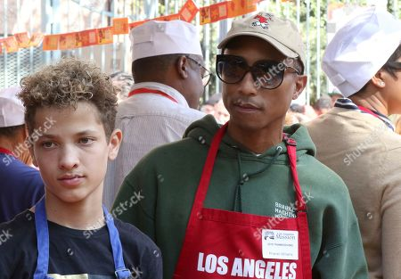 Jaid Thomas Nilon, Pharrell Williams. Jaid Thomas Nilon, left, and Pharrell Williams volunteer to serve Thanksgiving dinner to a group of homeless people at the Los Angeles Mission, in Los Angeles