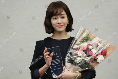 South Korean Actress Han Ji-min poses for photos after being named the honorary ambassador against child abuse at a ceremony in Seoul, South korea, 21 November 2018.