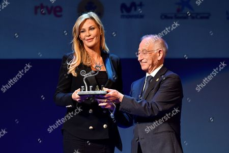 Alison Doody (L) receives the 'Almeria tierra de cine' award, coinciding with the 30th anniversary of the film 'Indiana Jones and the last crusade', from Almeria's Council President Gabriel Amat (R) during the Almeria's Cinema International Festival gala held at the Cervantes Theatre in Almeria, southern Spain, 21 November 2018.