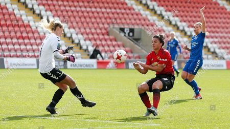 Jess Sigsworth of Manchester United Women and Goalkeeper Hannah Reid of Durham