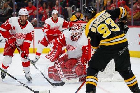 Detroit Red Wings goaltender Jimmy Howard (35) blocks a Boston Bruins left wing Brad Marchand (63) shot in the first period of an NHL hockey game, in Detroit