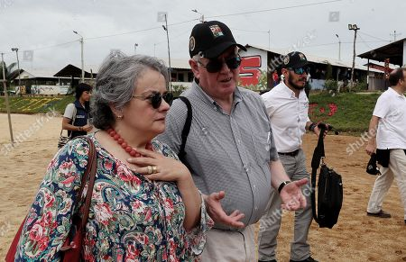 The special envoy of the European Union for Peace, Eamon Gilmore (C), speaks with the ambassador of Portugal, Gabriela Soares (L), during his visit to the Territorial Space for Training and Reintegration (ETCR) in La Montanita in Caqueta, Colombia, 21 November 2018. The representatives visited the department of Caqueta to learn about two of the development projects sponsored by the organization.