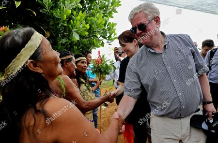 The special envoy of the European Union for Peace Eamon Gilmore (R) greets a group of indigenous people greets a group in the village Luz de la Esperanza in La Montanita in Caqueta, Colombia, 21 November 2018. The representatives visited the department of Caqueta to learn about two of the development projects sponsored by the organization.