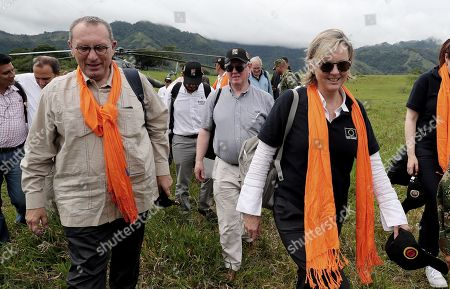 The Director General of Cooperation and Development for the European Union, Stefano Manservisi (3-L), the special envoy of the European Union for Peace, Eamon Gilmore (C, right) and the ambassador of the European Union Patricia Llombart (R) walk through a field during their visit to the Territorial Space for Training and Reintegration (ETCR) in La Montanita in Caqueta, Colombia, 21 November 2018. The representatives visited the department of Caqueta to learn about two of the development projects sponsored by the organization.