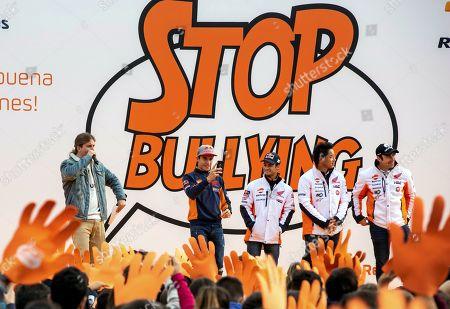 Stock Picture of Repsol Honda team members, Spanish Moto GP pilots Marc Marquez (2-L) and Dani Pedrosa (C), TrialGP World Champion, Spanish Toni Bou (R), and Japanese trial rider Takahisa Fujinami (2-R) visit Salesianos school in Zaragoza, Spain, 22 November 2018. Salesianos has won Repsol contest against bullying in the schools.