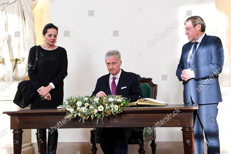 Stock Picture of Christine Defraigne, King Philippe and Siegfried Bracke during a visit of the Belgian king to the federal parliament to commemorate the 100th anniversary of the speech of King Albert I