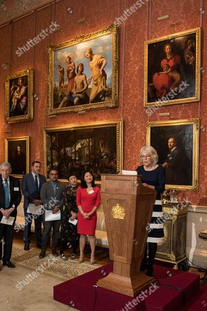Stock Photo of David Walliams (2L), Nikesh Shukla (3L), Sharlene Teo (3R), Dr Linda Yueh (2R) and Camilla Duchess of Cornwall (R), Vice Patron of The Royal Commonwealth Society, on behalf of Queen Elizabeth II, Patron of The Royal Commonwealth Society, during a reception for winners of The Queen's Commonwealth Essay Competition