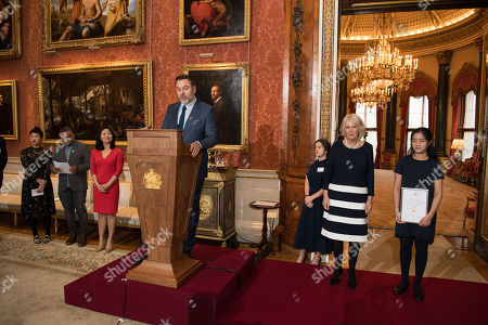 Stock Image of Sharlene Teo (L), Nikesh Shukla (2L), David Walliams (4L) and Camilla Duchess of Cornwall (2R), Vice Patron of The Royal Commonwealth Society, on behalf of Queen Elizabeth II, Patron of The Royal Commonwealth Society, with Ng Woon Neng (R), Senior Runner Up, during a reception for winners of The Queen's Commonwealth Essay Competition