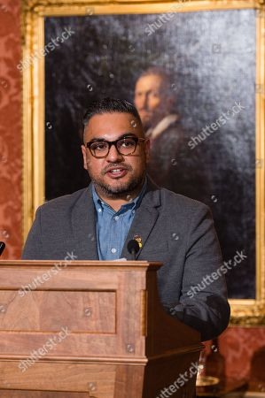 Stock Photo of Nikesh Shukla speaks during a reception for winners of The Queen's Commonwealth Essay Competition