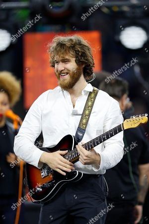 Singer Mike Posner prepares to perform during halftime of an NFL football game between the Detroit Lions and the Chicago Bears, in Detroit