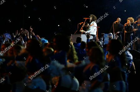 Singer Mike Posner performs during halftime of an NFL football game between the Detroit Lions and the Chicago Bears, in Detroit