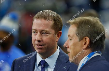 Detroit Lions Executive VP and General Manager Bob Quinn talks with Vice Chairman Bill Ford during pregame of an NFL football game \av\, in Detroit