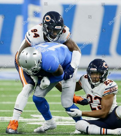 Chicago Bears outside linebacker Leonard Floyd (94) cornerback Kyle Fuller (23) stop Detroit Lions wide receiver Andy Jones (17) during the second half of an NFL football game, in Detroit