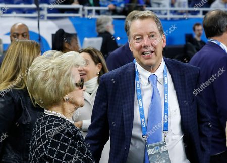 Detroit Lions owner Martha Firestone Ford talks to son and Vice Chairman Bill Ford during pregame of an NFL football game, in Detroit