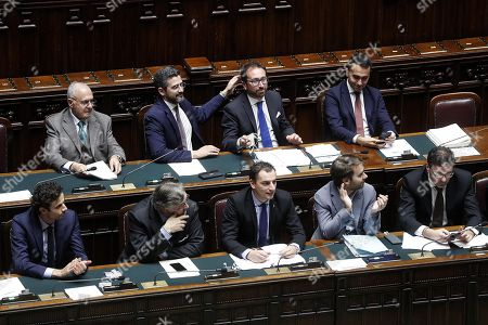 (L-R, top row) Italian Minister for European Affairs, Paolo Savona, Italian Minister for Relations with Parliament, Riccardo Fraccaro, Italian Justice Minister Alfonso Bonafede and Italian Deputy Premier Luigi Di Maio during the vote on the government's anti-corruption bill, in Rome, Italy, 22 November 2018. The Lower House on Thursday approved the government's anti-corruption bill with 288 ayes and 143 nays. The measures moves to the Senate. The measure, which had been held up by a No vote to an amendment on embezzlement which was later reversed, contains a crackdown on graft.