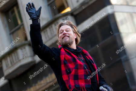"Stock Image of Musical artist Craig Wayne Boyd, winner of season 7 of the television competition ""The Voice"" waves to spectators during the Thanksgiving Day Parade in Philadelphia, November 22, 2018."
