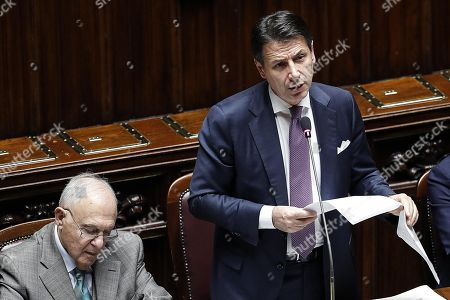 Italian Prime Minister Giuseppe Conte (R) speaks next to Minister for European Affairs Paolo Savona (L) during a session on Italian budget at the Chamber of Deputies in Rome, Italy, 22 November 2018. European Commission had rejected on 21 November Italy's proposed 2019 budget over excessive spendings.