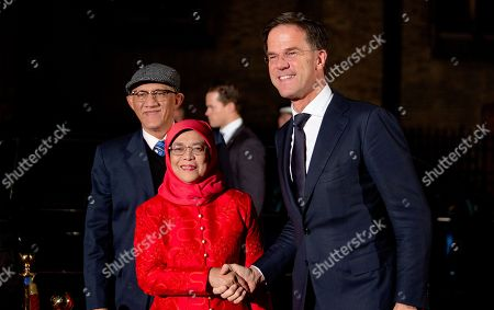 Prime Minister Mark Rutte with President Halimah Yacob of the Republic of Singapore and her husband Mohamed Abdullah Alhabshee