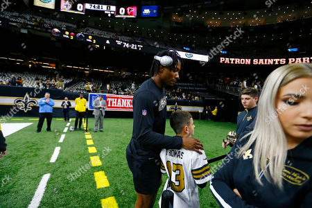 New Orleans Saints wide receiver Brandon Marshall signs autographs before an NFL football game against the Atlanta Falcons in New Orleans