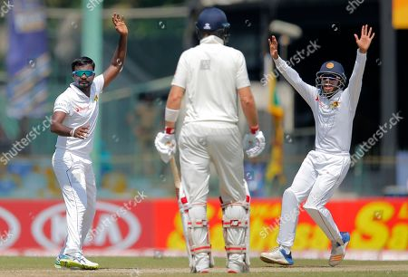 Sri Lanka's Malinda Pushpakumara, left, unsuccessfully appeals for the wicket of England's Jonathan Bairstow during the first day of the third test cricket match between Sri Lanka and England in Colombo, Sri Lanka