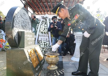 Stock Picture of South Korea's Marine Corps Commander, Lt. Gen. Jun Jin-goo, burns incense in front of the graves of two marines killed in North Korea's 2010 shelling of Yeonpyeong Island on the western sea border as he attends a memorial at the National Cemetery in Daejeon, central South Korea, 23 November 2018.