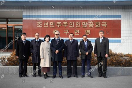 Stock Image of Asia Football Confederation President Salman Bin Ibrahim Al-Khalifa, fourth from left, and his company visit the Football Association of North Korea at Pyongyang International football school in Pyongyang