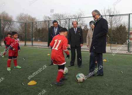 Stock Photo of Asia Football Confederation President Salman Bin Ibrahim Al-Khalifa, right, visits the Football Association of North Korea at Pyongyang International football school in Pyongyang