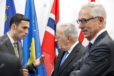 Kosovo's Minister of Trade and Industry Endrit Shala (L) speaks with Swiss Minister of Economic Johann Schneider-Ammann (C) past the Secretary-General of the European Free Trade Association (EFTA) Swiss Henri Getaz (R) after signing a political declaration between the EFTA and Kosovo, during an EFTA Ministerial meeting at the headquarters of the European Free Trade Association, in Geneva, Switzerland, 23 November 2018.