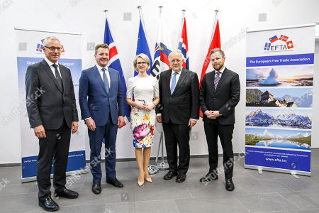 (L-R) Secretary-General of the European Free Trade Association (EFTA) Henri Getaz, Iceland's Minister for Foreign Affairs Gulaugur Thor Thordarson, Liechtenstein's Minister of Foreign Affairs Aurelia Frick, Swiss Minister of Economic Johann Schneider-Ammann, and Norway's Minister of Trade and Industry Torbjorn Roe Isaksen, pose for an official photo during an EFTA Ministerial meeting at the headquarters of the European Free Trade Association, in Geneva, Switzerland, 23 November 2018.