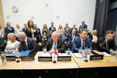 Swiss Minister of Economic Johann Schneider-Ammann (C) signs a document while sitting next to Liechtenstein's Minister of Foreign Affairs Aurelia Frick (L), Secretary-General of the European Free Trade Association (EFTA) Swiss Henri Getaz (2-L), Iceland's Minister for Foreign Affairs Gulaugur Thor Thordarson, (2-R), and Norway's Minister of Trade and Industry Torbjorn Roe Isaksen (R) during the signing ceremony of political declaration between EFTA and Kosovo, at the EFTA Ministerial meeting, at the headquarters of the European Free Trade Association, in Geneva, Switzerland, 23 November 2018.