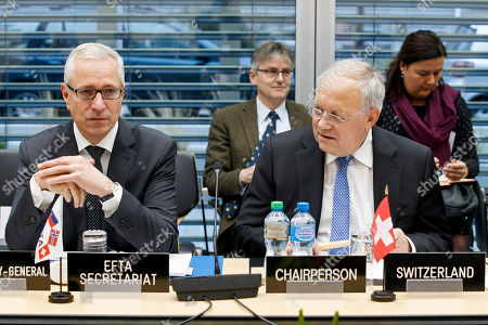 Swiss Minister of Economic Johann Schneider-Ammann (R), sitting next to Secretary-General of the European Free Trade Association (EFTA) Swiss Henri Getaz (L), delivers his speech during an EFTA Ministerial meeting at the headquarters of the European Free Trade Association, in Geneva, Switzerland, 23 November 2018.