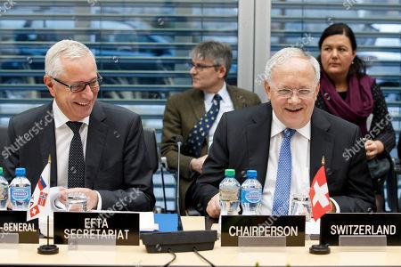 Swiss Minister of Economic Johann Schneider-Ammann (R), sitting next to Secretary-General of the European Free Trade Association (EFTA) Swiss Henri Getaz (L), laughs prior to an EFTA Ministerial meeting at the headquarters of the European Free Trade Association, in Geneva, Switzerland, 23 November 2018.