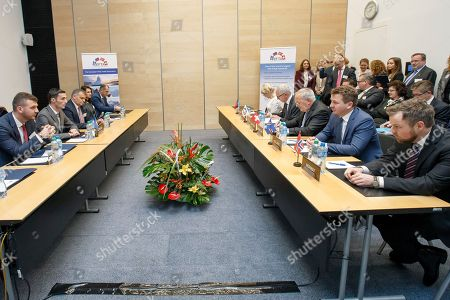 Kosovo's Minister of Trade and Industry Endrit Shala (2-L), sitting in front of Liechtenstein's Minister of Foreign Affairs Aurelia Frick (5-R), Secretary-General of the European Free Trade Association (EFTA) Swiss Henri Getaz (4-R), Swiss Minister of Economic Johann Schneider-Ammann, #-R), Iceland's Minister for Foreign Affairs Gulaugur Thor Thordarson (2-R), Norway's Minister of Trade and Industry Torbjorn Roe Isaksen (R), listens to a speech, during the signing ceremony of political declaration between EFTA and Kosovo, at the EFTA Ministerial meeting, at the headquarters of the European Free Trade Association, EFTA, in Geneva, Switzerland, 23 November 2018.