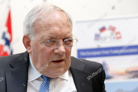 Swiss Minister of Economic Johann Schneider-Ammann speaks to reporter during an EFTA Ministerial meeting at the headquarters of the European Free Trade Association, EFTA, in Geneva, Switzerland, 23 November 2018.